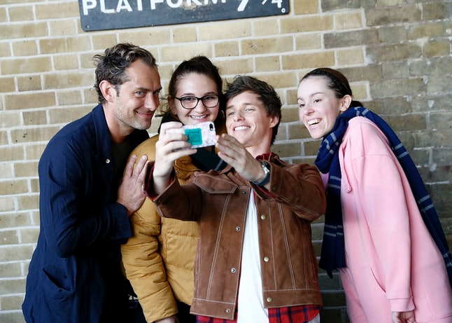 Eddie Redmayne and Jude Law, stars of 'Fantastic Beasts: The Crimes Of Grindelwald,' surprise fans at Platform 9 3/4 during 'Back to Hogwarts' day celebration at Kings Cross Station on Sept. 1 in London.