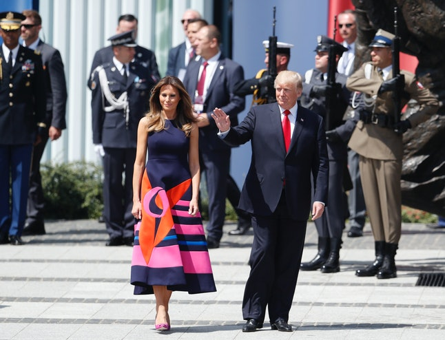 Melania Trump and her husband arrive for a speech in Poland