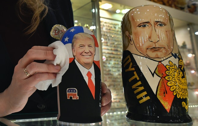 An employee polishes traditional Russian wooden nesting dolls, Matryoshka dolls, depicting U.S. President-elect Donald Trump (L) and Russian President Vladimir Putin at a gift shop in central Moscow on January 16, four days ahead of Trump's inauguration.