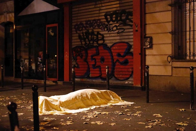 A dead body lays in the streets of Paris after the Nov. 13, 2015, terror attacks that killed 130 people in the city.