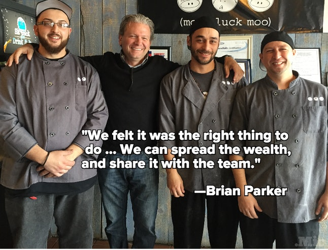 Co-founder Brian Parker, second from left, and three Moo Cluck Moo employees