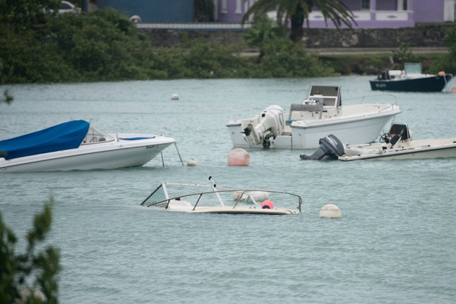Boats were let flipped or swamped after Hurricane Nicole.