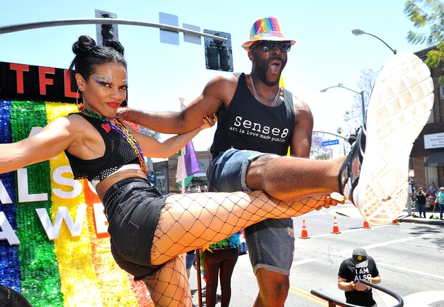Freema Agyeman (left) and Toby Onwumere (right) on a float at the Los Angeles Pride Parade