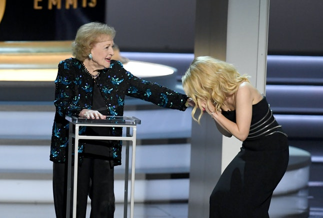 Betty White and Kate McKinnon speak onstage during the 70th Emmy Awards at Microsoft Theater on Sept. 17 in Los Angeles.