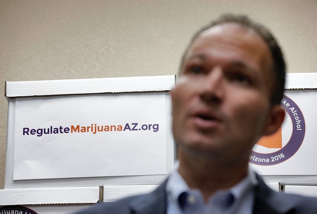 J.P. Holyoak, chairman of Regulate Marijuana Like Alcohol in Arizona, speaks at a press conference after delivering boxes of signatures to put marijuana legalization on the November ballot.