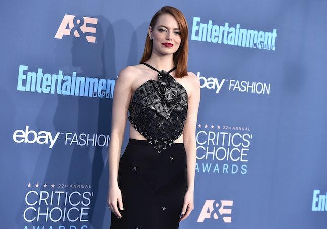 Emma Stone arrives at the 22nd annual Critics' Choice Awards at the Barker Hangar on Sunday, Dec. 11, 2016, in Santa Monica, California.