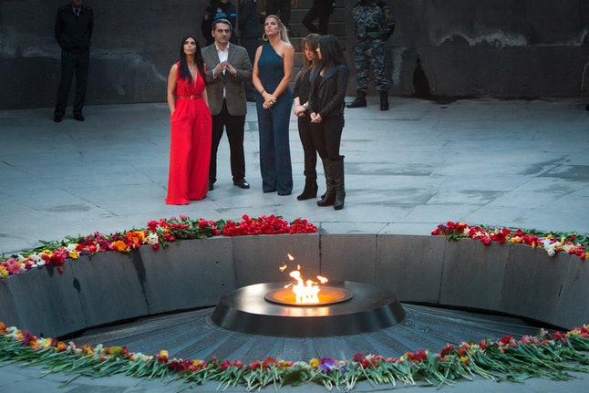 Kim Kardashian and sisters Kourtney and Khloe visit an Armenian genocide memorial.
