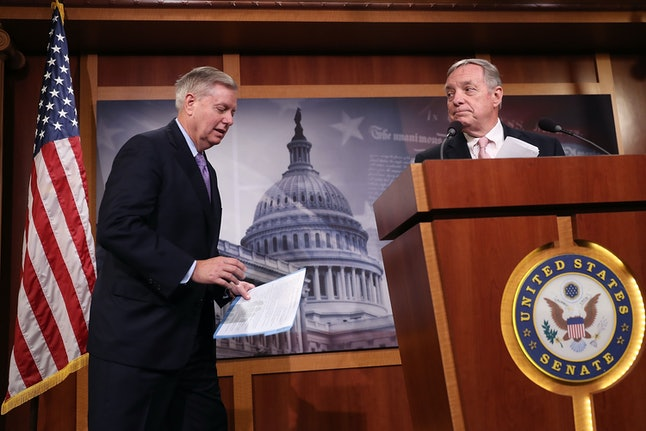 Sens. Dick Durbin and Lindsey Graham speak on the DREAM Act in July 2017.
