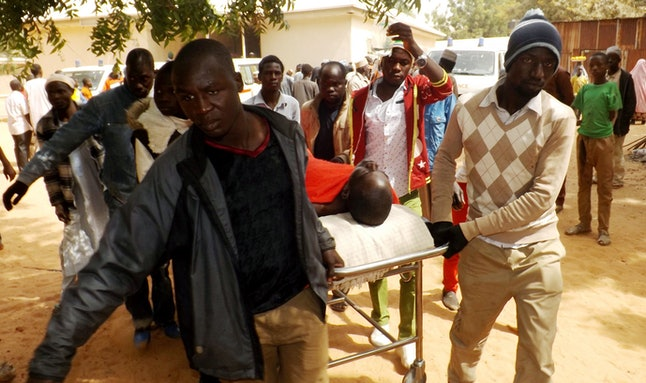 A man injured in a suicide blast is transported at the General Hospital in northeast Nigerian town of Potiskum on Jan. 12. Four people were killed and 46 injured when two female suicide bombers detonated their explosives outside a mobile phone market in the town on Jan. 11.
