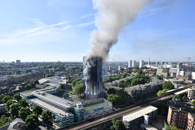 Smoke rose from the building after a huge fire engulfed the 24-story residential Grenfell Tower block West London in the early hours of Wednesday morning.