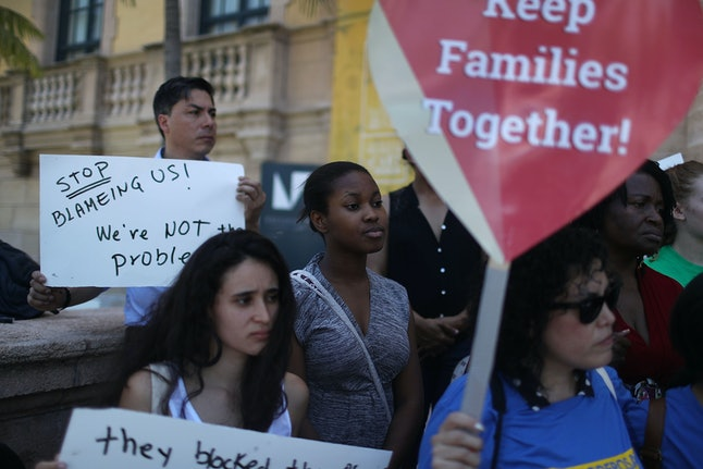 Activists protest the Supreme Court ruling against Obama's immigration plan in Miami.