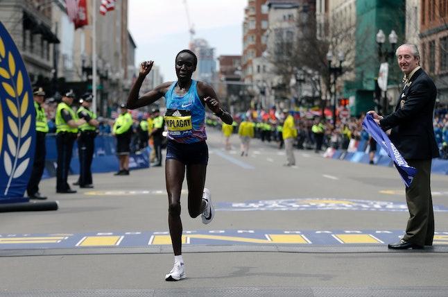 Edna Kiplagat crosses the finish line at the 2017 Boston Marathon.