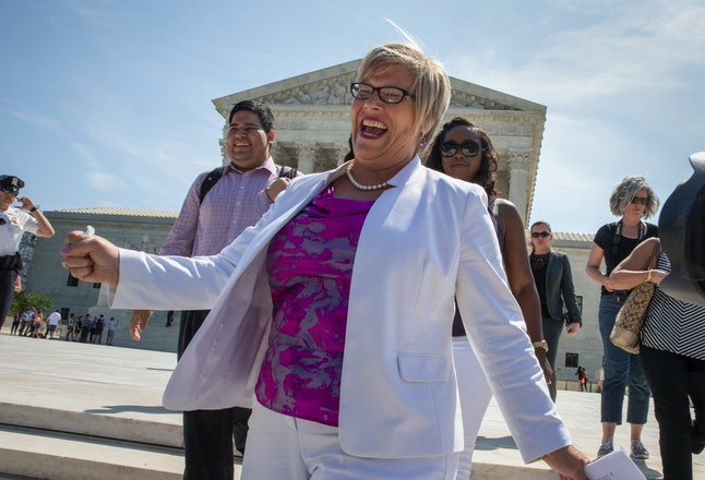 Amy Hagstrom Miller, founder of Texas reproductive health clinic Whole Woman's Health, rejoices as she leaves the Supreme Court after the court struck down the strict Texas anti-abortion restriction law known as HB2.