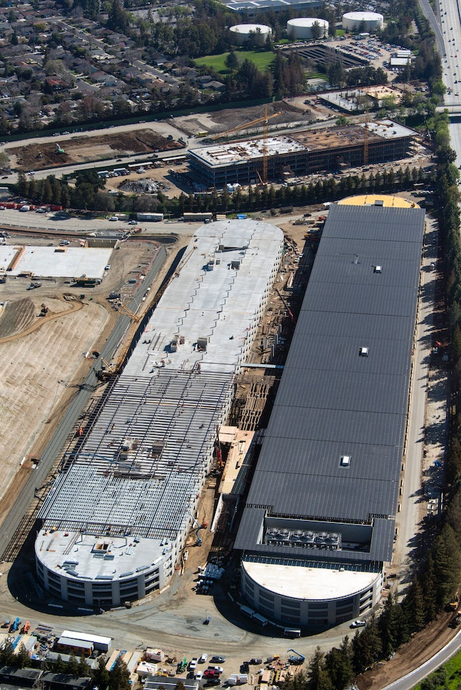Parking structures on Apple's new campus. The one on the right features the solar panels.