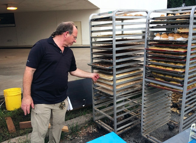 Bobby Jucker, owner of Three Brothers Bakery, assesses the storm damage at his Houston bakery.