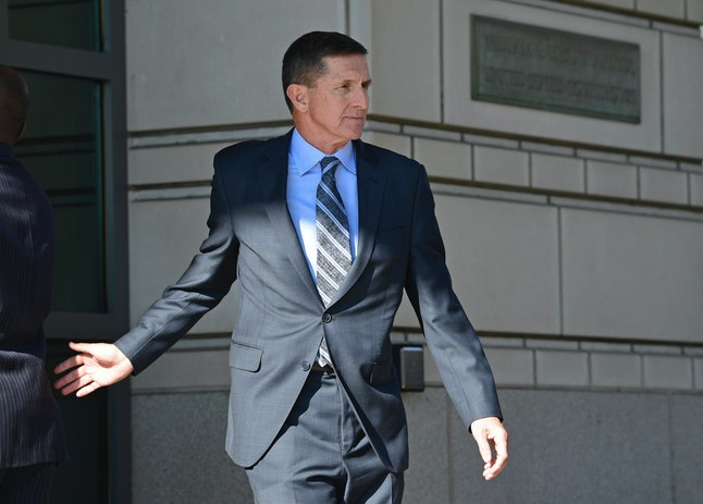 Michael Flynn leaves federal court in Washington, D.C., Friday after pleading guilty to a charge of lying to FBI agents.