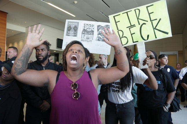 Patrisse Cullors gestures in protest of the police shooting death of Carnell Snell Jr., at the headquarters of the Los Angeles Police Department.
