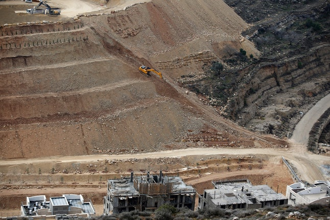 Israeli excavators working at a settlement site on the West Bank.