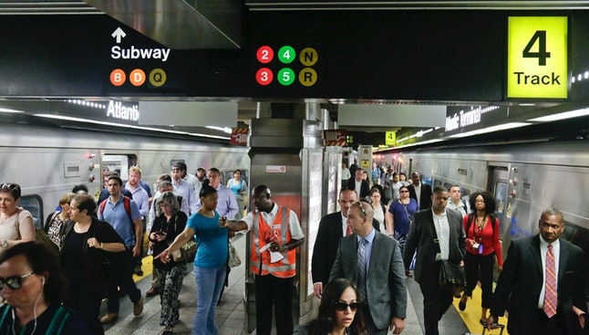 MTA personnel, center, direct Long Island Rail Road commuters to subway options at Atlantic Terminal in Brooklyn, Monday July 10.