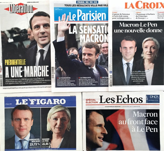 The covers of France's national newspaper announcing the election results.