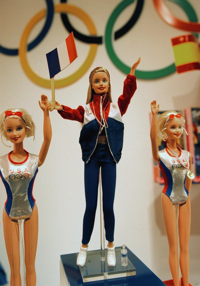 Barbie dolls for the Olympics are displayed by Mattel at the American International Toy Fair, February 14, 2000