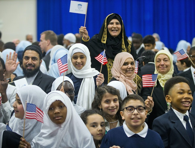 Children and guests greet President Barack Obama in February during his visit to the Islamic Society of Baltimore.