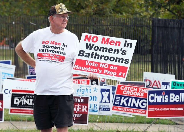 """An opponent to Houston's Equal Rights Ordinance holds a sign calling on voters to vote """"No"""" on Proposition 1."""