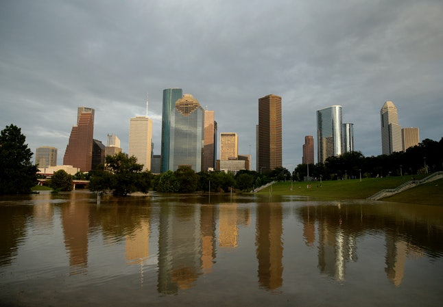 Dowtown Houston is reflected in flooded Buffalo Bayou, as the city continues to recover from record flooding caused by Tropical Storm Harvey, on Aug. 30.