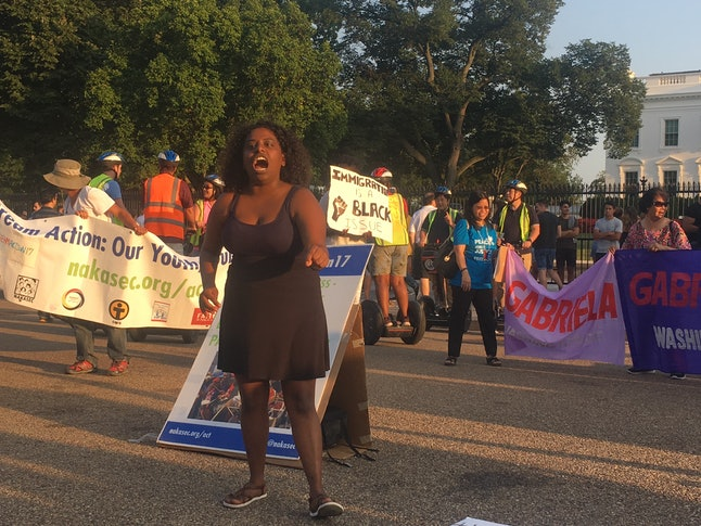 Deborah Alemu, of Undocublack Network, speaks to protesters in front of the White House on Saturday, Aug. 26. As President Donald Trump considers ending the DACA program, diverse groups of immigrants are speaking out about how they would be impacted.