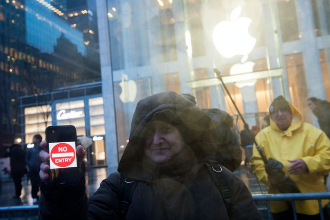 """A protester holds up an iPhone that reads """"No entry"""" in 2016."""
