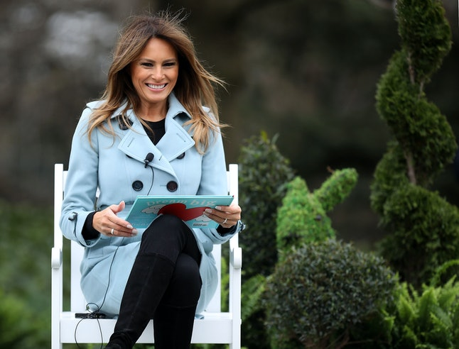 Melania Trump reads to children at the White House Easter Egg Roll.