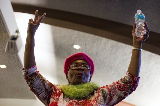 Freddie Fisher, 63, holds up a bottle of water while dancing at a city council meeting in Flint on Feb. 3.