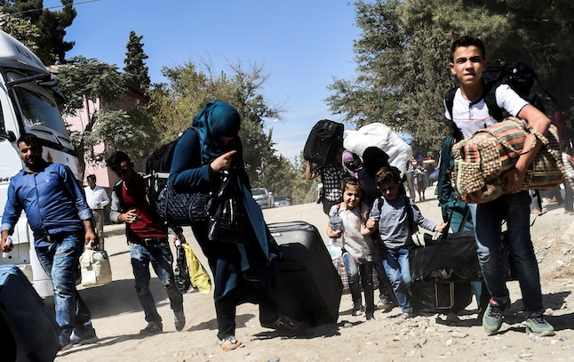 Syrian refugees in Turkey flee violence in this photo from last month.