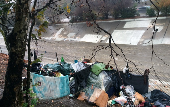A homeless encampment, build along the bed of a Los Angeles river.