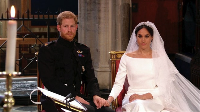 Prince Harry and Meghan Markle listen at their wedding ceremony at St. George's Chapel in Windsor Castle.