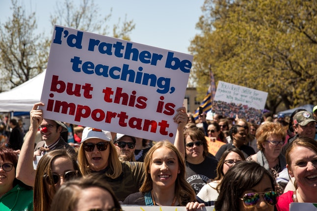 Thousands gathered and marched in a picket line outside the Oklahoma state Capitol building during the third day of a statewide education walkout on April 4 in Oklahoma City. Teachers and their supporters are demanding increased school funding and pay raises for school workers.