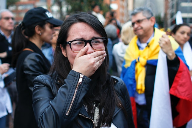 """A proponent of the peace deal breaks down in tears as she learns of the """"no"""" campaigns success in the referendum."""