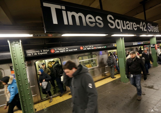 Subway passengers walk through the 42nd Street-Times Square station in New York City.