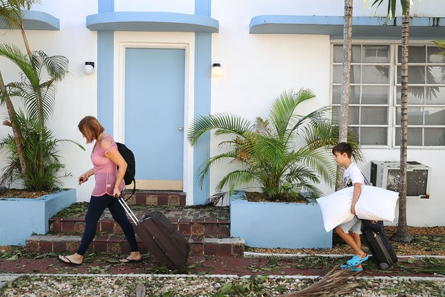 Maria Soto and Michael Perez return home for the first time after seeking shelter in a friend's home when Hurricane Irma passed through the area on Sept. 12 in Miami Beach, Florida.