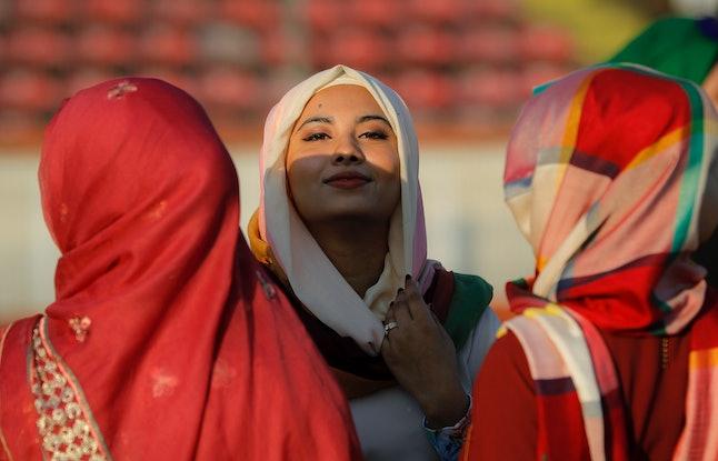 Women wait before Eid al-Fitr prayers in Bucharest, Romania, on Sunday.