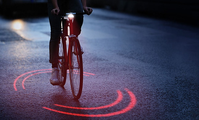 When a car approaches a cycle, the single line laser turns into a double line laser and spins faster.