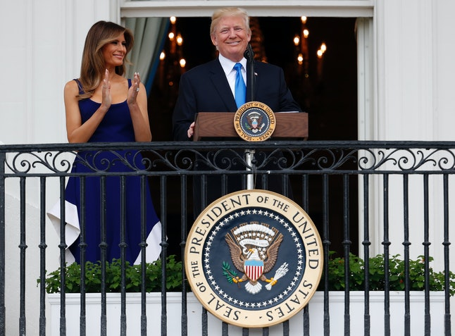 Melania Trump and President Donald Trump after speaking from the Truman Balcony at the Fourth of July White House picnic