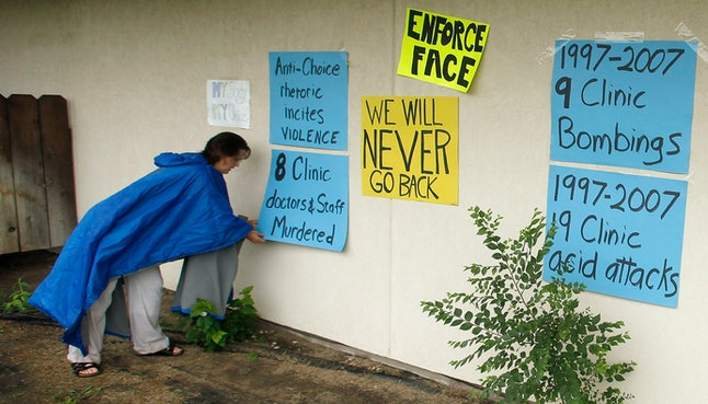 Activists place signs outside of Tiller's facility after his death.