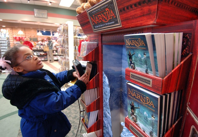 Nyshla Esters, 8, looks at the Chronicles of Narnia display at Family Christian Stores Thursday, Dec. 8, 2005, in in Kalamazoo, Michigan.