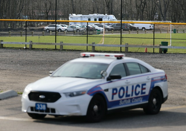 Emergency vehicles seen in a Long Island park in Central Islip, New York, Thursday, April 13.