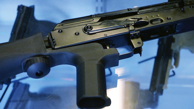 """A """"bump stock"""" device attached to a semi-automatic rifle at the Gun Vault store and shooting range in South Jordan, Utah."""