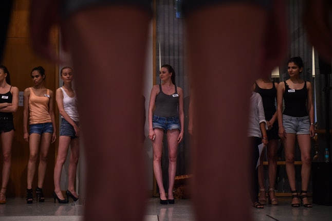 Models prepare to walk during the female model casting session for India Couture Week 2016.