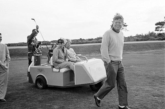 President John F. Kennedy walks down the fairway of a Rhode Island golf course in 1963.
