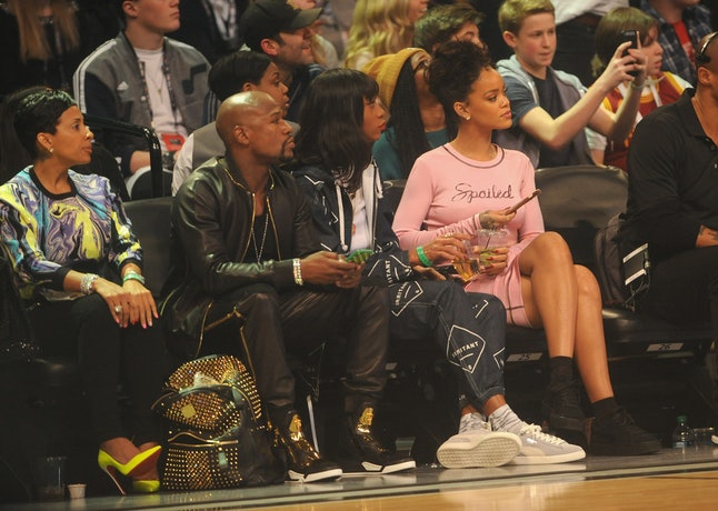 Rihanna (far right) attends NBA All-Star Weekend 2015 at the Barclays Center