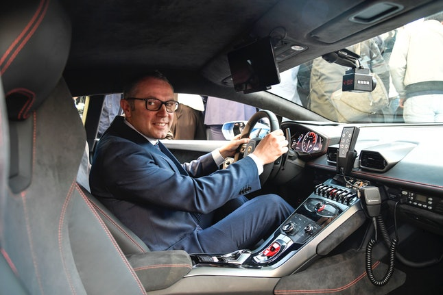 Lamborghini CEO Stefano Domenicali sits in the Huracán Polizia during the ceremony on Thursday.